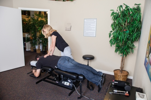 Dr. Jen performing and Adjustment